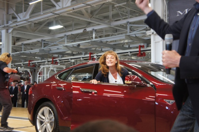 Investor Nancy Pfund getting into her Model S at the Tesla factory on the day of the launch of the Model S.